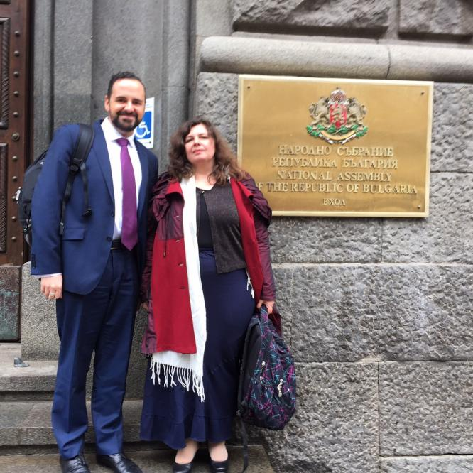 Dr. Oliver Lewis (MDAC Executive Director) and Aneta Genova (MDAC Lawyer) outside the Bulgarian National Assembly, Sofia